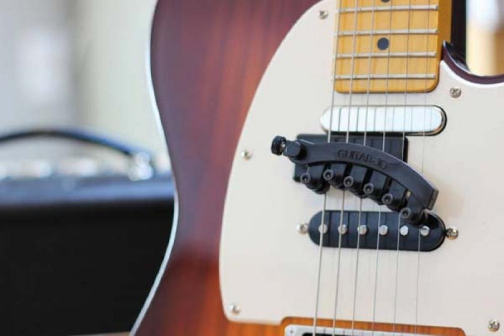Una sordina per trasformare la chitarra in un banjo